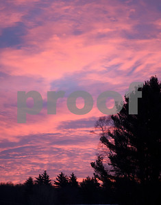 Robert Layman / Staff Photo  The sun hid behind the clouds for most of the day, but caused the sky to be filled with pink and red hues as it rose Thursday, Jan. 11, 2018.