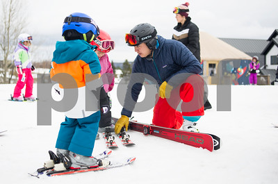 Robert Layman / Staff Photo  Justin Guth, Risk Manager at Killington Ski Resort, works with Killington Elementary School students during their lesson outside of Ramshead Lodge Thursday afternoon, Jan. 11, 2018.