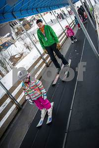 Robert Layman / Staff Photo  Killington Elementary School students and their parents ride the magic carpet ride at Killington Ski Resort Thursday afternoon, Jan. 11, 2018. KES ran learn-to-ski event with parents Thursday.