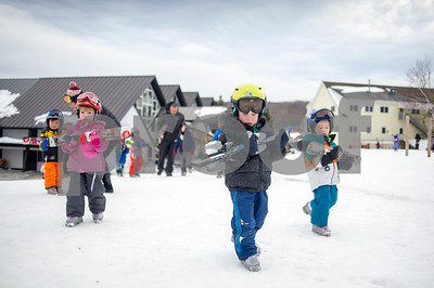 Robert Layman / Staff Photo Killington Elementary School students hoof their skis out to the learning area outside of Ramshead Lodge Thursday, Jan. 11, 2018.