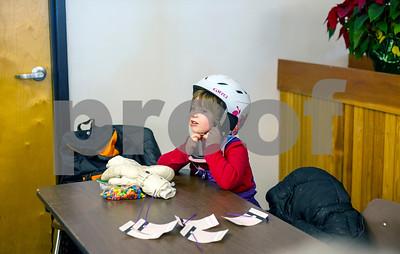 Robert Layman / Staff Photo A Killington Elementary School student latches on their helmet Thursday morning, Jan. 11, 2018.