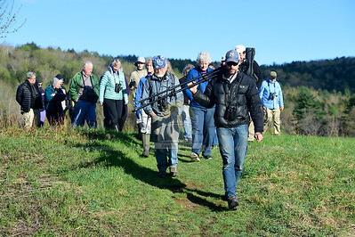 Jeb Wallace-Brodeur / Staff Photo Naturalist Sean Beckett leads a large group of birdwatchers on an early-morning outing Friday at the North Branch Nature Center in Montpelier. The center is offering a series of Friday Morning Bird Walks at various locations throughout central Vermont through the first of June.