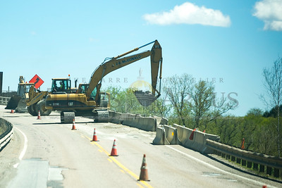 Construction crews work on Route 2 near Middlesex on Monday.  Josh Kuckens/Staff Photo