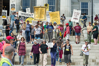 Activists and local leaders gather on the State House Steps on Monday as the Poor People's Campaign holds a rally.  Josh Kuckens/Staff Photo