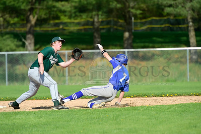 Jeb Wallace-Brodeur / Staff Photo Montpelier's Isaak Donahue waits for the throw as U-32's Eli Oliver safely steals second base during their game Wednesday.