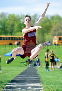 Jeb Wallace-Brodeur / Staff Photo Spaulding's Nick Norwood competes in the long jump competition Thursday at the U-32 freshman and sophomore track meet.