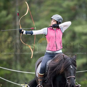 Thryn Franz of Boston, MA takes takes aim at a target during a New England Mounted Archery clinic at Briar Hill Farm in East Calais on Sunday.  Josh Kuckens/Staff Photo