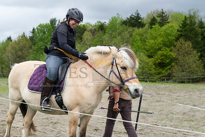 Julie Miller of Simsbury, CT praises her Norwegian Fjord Horse during a New England Mounted Archery clinic at Briar Hill Farm in East Calais on Sunday.  Josh Kuckens/Staff Photo
