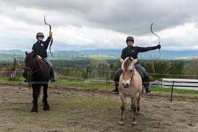 (L to R)Heather Evans of Chichester, NH and Julie Miller of Simsbury, CT pose for a portrait during a New England Mounted Archery clinic at Briar Hill Farm in East Calais on Sunday.  Josh Kuckens/Staff Photo