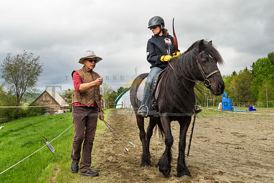 Heather Evans of Chichester, NH takes direction from Marcy Baer during a New England Mounted Archery clinic at Briar Hill Farm in East Calais on Sunday.  Josh Kuckens/Staff Photo