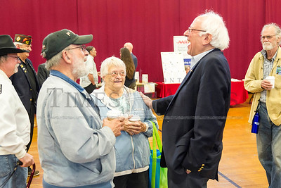 Jim and Jeanne Gricci of Northfield share a laugh with Sen. Bernie Sanders on Saturday during a Veterans town hall and resource fair at Norwich University.  Josh Kuckens/Staff Photo
