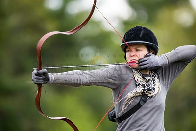 Amanda Franz of Plainfield takes aim at a target during a New England Mounted Archery clinic at Briar Hill Farm in East Calais on Sunday.  Josh Kuckens/Staff Photo