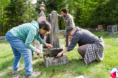 Barb Baird (right) leads a group of volunteers in the cleaning of gravestones at Old Fairview Cemetery in East Calais on Saturday.   Josh Kuckens/Staff Photo