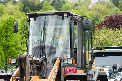 William Manahan, 8, of Montpelier sits in the driver's seat of a city bulldozer on Sunday during the Touch a Truck event at Montpelier High School.  Josh Kuckens/Staff Photo