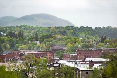 Fog rises in the hills over downtown Barre on Sunday.  Josh Kuckens/Staff Photo