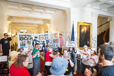 Activists and local leaders occupy the main lobby of the State House on Monday in Montpelier as the Poor People's Campaign enters its second week of demonstrations.  Josh Kuckens/Staff Photo