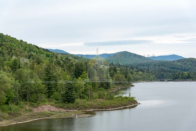 The Worcester Range looms over the Wrightsville Reservoir in Middlesex on Tuesday.  Josh Kuckens/Staff Photo