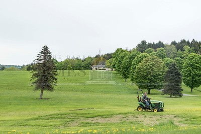 Overcast skies made for easier lawn maintenance conditions in Montpelier on Tuesday.  Josh Kuckens/Staff Photo