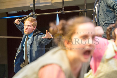 (Left) Officer Barnel, played by Eric David Miller, runs through a scene from Urinetown at Lost Nation Theater on Tuesday.  Josh Kuckens/Staff Photo