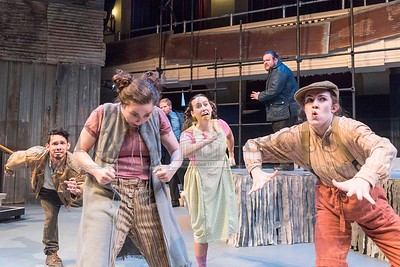 (From left to right) Hot Blades Harry, played by Jordy Diaz, Sarpy Sue, played by Sarah Milnamow, Little Sally, played by Madison Johnson, and Tiny Tom, played by Jessie Del Rio, run through a scene from Urinetown at the Lost Nation Theater on Tuesday.  Josh Kuckens/Staff Photo