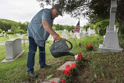 John Laing of Franklin visits his relative's graves at Hope Cemetery in Barre on Monday. John's father, Frederick Laing, and uncle, George H. Laing, served in World War II.   Josh Kuckens/Staff Photo