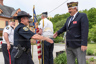 Montpelier Police Chief Tony Facos greets VT VFW Post #792 Past State Commander Michael Choquette as marchers prepare for the Memorial Day Parade on Monday.  Josh Kuckens/Staff Photo