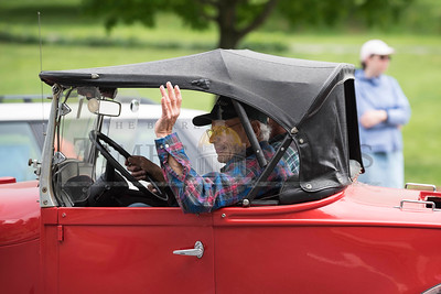 Roland Pepin waves to the crowd from his 1929 Ford during the Montpelier Memorial Day Parade on Monday.  Josh Kuckens/Staff Photo