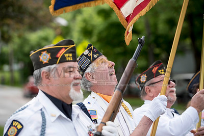 American Legion Post #3's Dick Harlow adjusts his flag as the color guard prepares to march in the Montpelier Memorial Day Parade on Monday.  Josh Kuckens/Staff Photo