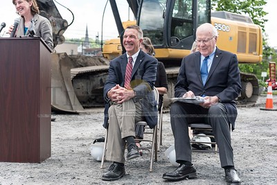 Governor Phil Scott and Senator Patrick Leahy share a laugh during the groundbreaking ceremony for the Taylor Street Transit Center on Tuesday in Montpelier.  Josh Kuckens/Staff Photo