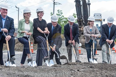 Local officials are joined by Senator Patrick Leahy and Governor Phil Scott at the groundbreaking ceremony for the Taylor Street Transit Center in Montpelier on Tuesday.  Josh Kuckens/Staff Photo
