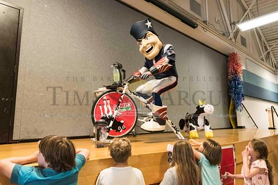 """Pat the Patriot, the official NFL mascot, uses a bicycle-propelled blender to make a """"Green Monster"""" smoothie on Tuesday at Barre City Elementary and Middle School. Pat appeared as part of Fuel Up to Play 60, a program created by the National Dairy Council and National Football League in collaboration with the U.S. Department of Agriculture to improve healthy eating and physical activity at schools and beyond.   Josh Kuckens/Staff Photo"""