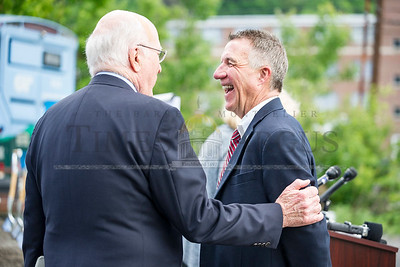 Governor Phil Scott and Senator Patrick Leahy share a laugh before the groundbreaking ceremony for the Taylor Street Transit Center on Tuesday in Montpelier.  Josh Kuckens/Staff Photo