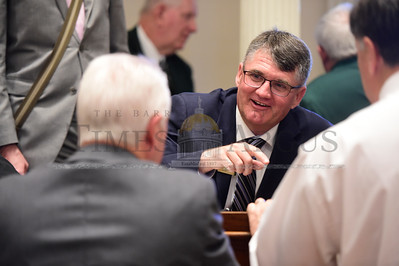Jeb Wallace-Brodeur / Staff Photo House minority leader Don Turner speaks with colleagues Wednesday as the Vermont House of Representatives reconvened for a special session.
