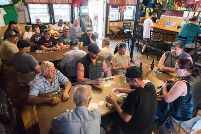 Poker players gather at The Pub in Williamstown on Sunday for a Texas Hold'em tournament benefitting the C.V.M.B.L scholarship fund.  Josh Kuckens/Staff Photo