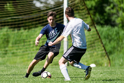 Crafstbury's Silas Lowenthal advances the ball against Hardwick on Sunday in Central Vermont Soccer League action.  Josh Kuckens/Staff Photo