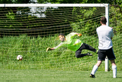 Craftsbury goalie Ryan Willette comes up short on a save against Hardwick on Sunday in Central Vermont Soccer League action.  Josh Kuckens/Staff Photo