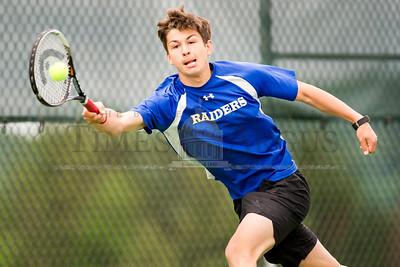 U32's Joe Franco returns a volley against Stowe on Tuesday.  Josh Kuckens/Staff Photo