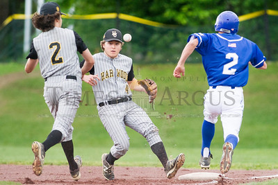 Lake Region's Dylan Gagnon (right) reaches first safely in Tuesday's semi-final as Harwood's Jake O'Brien (left) and Wyatt O'Brien (center) cannot come up with the play.  Josh Kuckens/Staff Photo