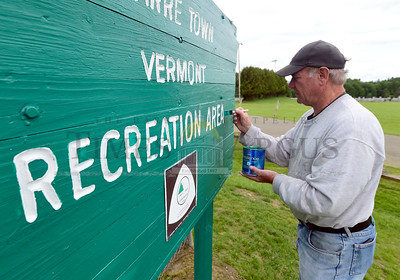 Jeb Wallace-Brodeur / Staff Photo Dwight Coffrin, grounds maintenance director for the Barre Town cemetery and recreation departments, puts a fresh coat of paint  on a sign at the recreation area Thursday. The area will be hosting the 4th annual Caws 4 Paws event on Saturday from 10-2 with animal-friendly vendors and organizations, the famous jumping Dock Dogs, police K-9's in action and many other demos.