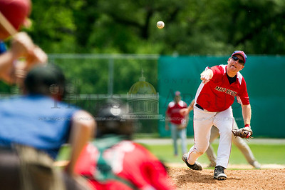 Mad River's Doc Simpson delivers to the plate against Montpelier in Senior League baseball action at the Montpelier Recreation Fields on Sunday.  Josh Kuckens/Staff Photo