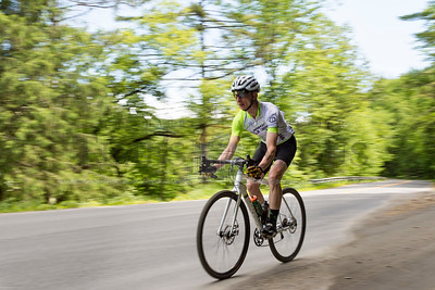 Cyclists ride along route 110 in Tunbridge on Sunday during The Ranger, a 32 mile course winding through dirt roads in Tunbridge and Royalton. The event benefits the Alliance for Vermont Communities, a group opposed to development in the area.  Josh Kuckens/Staff Photo