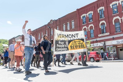 The Vermont Poor People's Campaign, joined by gubernatorial candidates James Ehlers and Christina Hallquist, marches from CCV offices on Stone Cutters Way to the State House in Montpelier on Monday. The campaign joined with CCV Union members demanding a new contract.  Josh Kuckens/Staff Photo