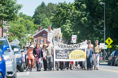 The Vermont Poor People's Campaign marches from CCV offices on Stone Cutters Way to the State House in Montpelier on Monday. The campaign joined with CCV Union members demanding a new contract.  Josh Kuckens/Staff Photo