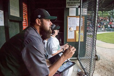 Mountaineers coach Joe Michaud keeps notes while watching the game against the Valley Blue Sox in Montpelier on Tuesday.  Josh Kuckens/Staff Photo