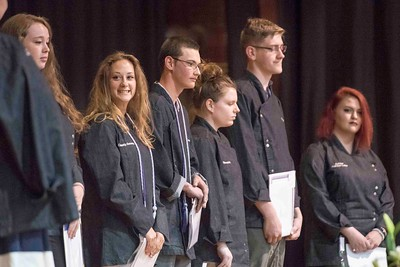 Cassidy Sweeney smiles with her fellow Baking Arts classmates on stage during the Central Vermont Career Center Awards Night & Celebration of Program Completers at the Barre Auditorium on Tuesday.  Josh Kuckens/Staff Photo