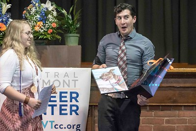 Amanda Adams presents her Digital Media Arts teacher Matthew Binginot with a painting of his dog during the Central Vermont Career Center Awards Night & Celebration of Program Completers at the Barre Auditorium on Tuesday.  Josh Kuckens/Staff Photo