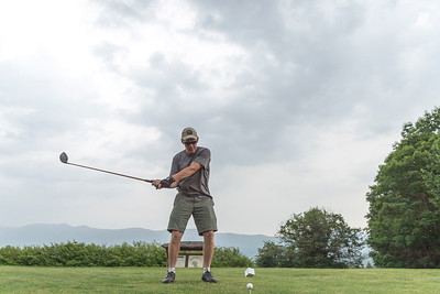Mark Roy of Waterbury Center tees off before approaching storms at Blush Hill in Waterbury on Monday.  Josh Kuckens/Staff Photo