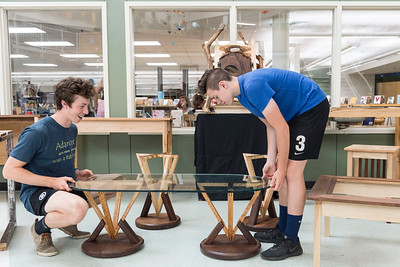 U-32 Woodworking students Dane Liebermann of East Montpelier (left) and Ben Basis of Roxbury (right) put the finishing touches on their end-of-year show on Monday.  Josh Kuckens/Staff Photo