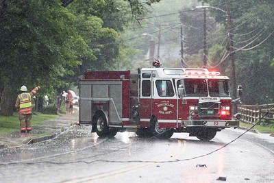 Montpelier Fire directs traffic on upper Elm Street as severe storms resulted in downed trees and wires Monday afternoon.  Josh Kuckens/Staff Photo