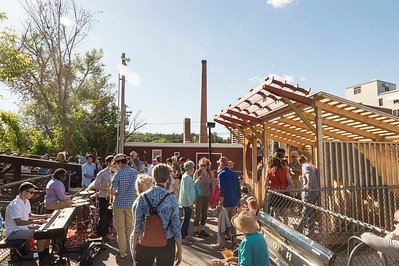 Citizens gather for the opening of Montpelier's Gurein Pocket Park at the walking bridge near Taylor Street on Tuesday.  Josh Kuckens/Staff Photo
